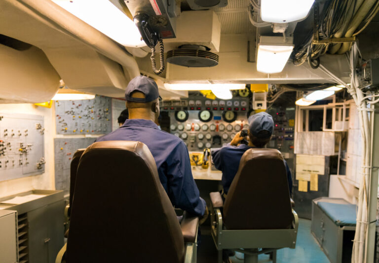 Personell at work on a aircraft carrier